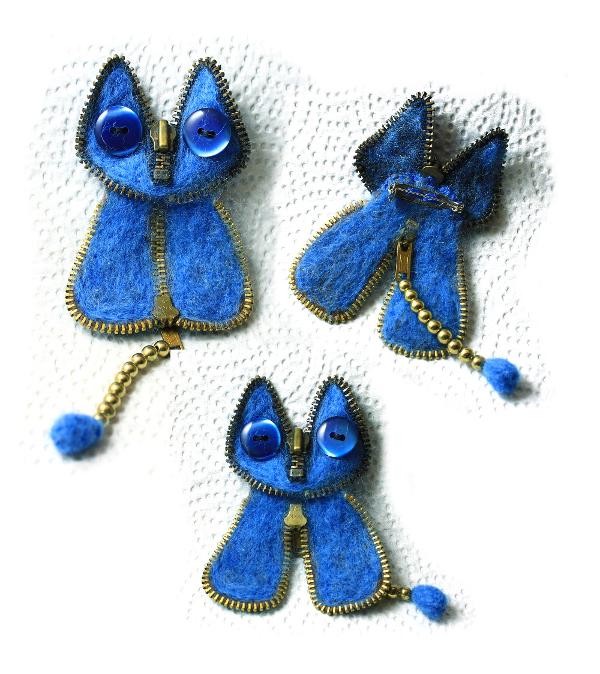Broche kat, gemaakt van van wol, knopen en een oude rits